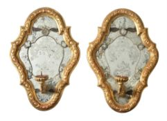 A pair of Italian carved giltwood and etched glass girandole wall mirrors