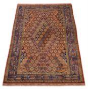 A Turkoman silk carpet