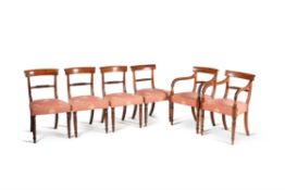 A set of ten late George III mahogany dining chairs
