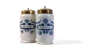 Two Dutch Delft blue and white cylindrical drug jars and gilt-metal covers