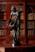 After Louis Leopold Chambard, a large patinated bronze model of a youth called 'Le Bucheron'