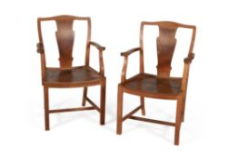 A pair of oak open armchairs, , by Heal's