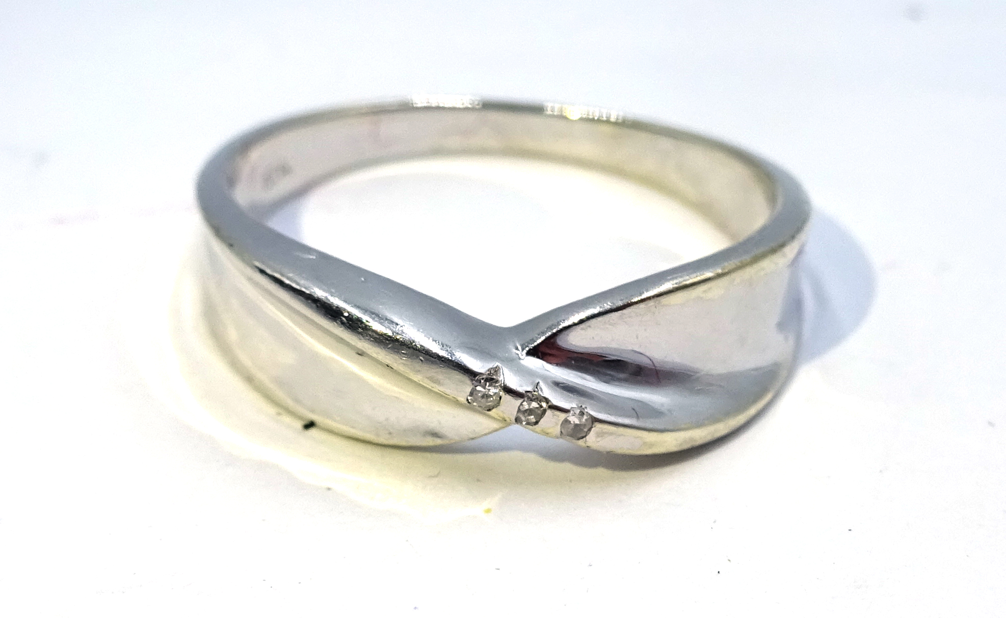 Lot 1026 - White gold diamond contemporary crossover ring,