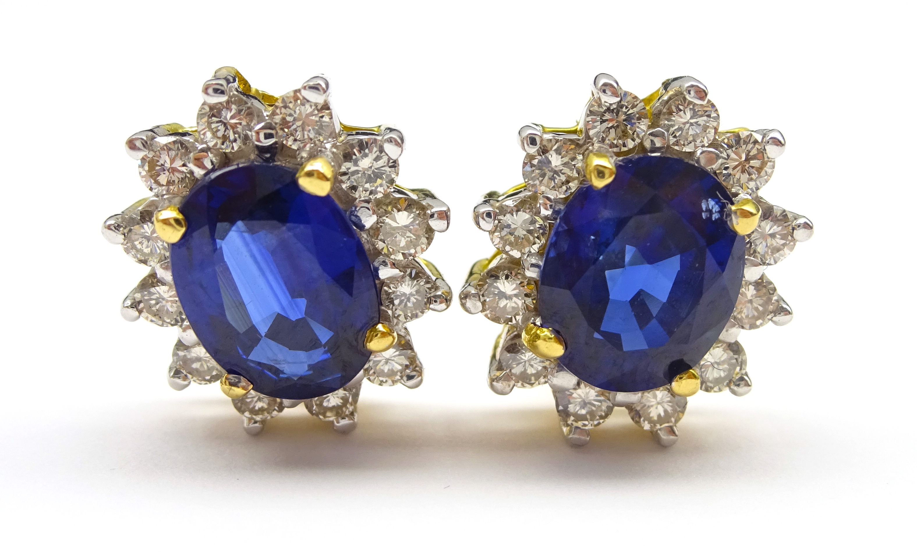 Lot 1031 - Pair of 18ct gold sapphire and diamond cluster stud earring stamped 750, sapphire total weight 2.