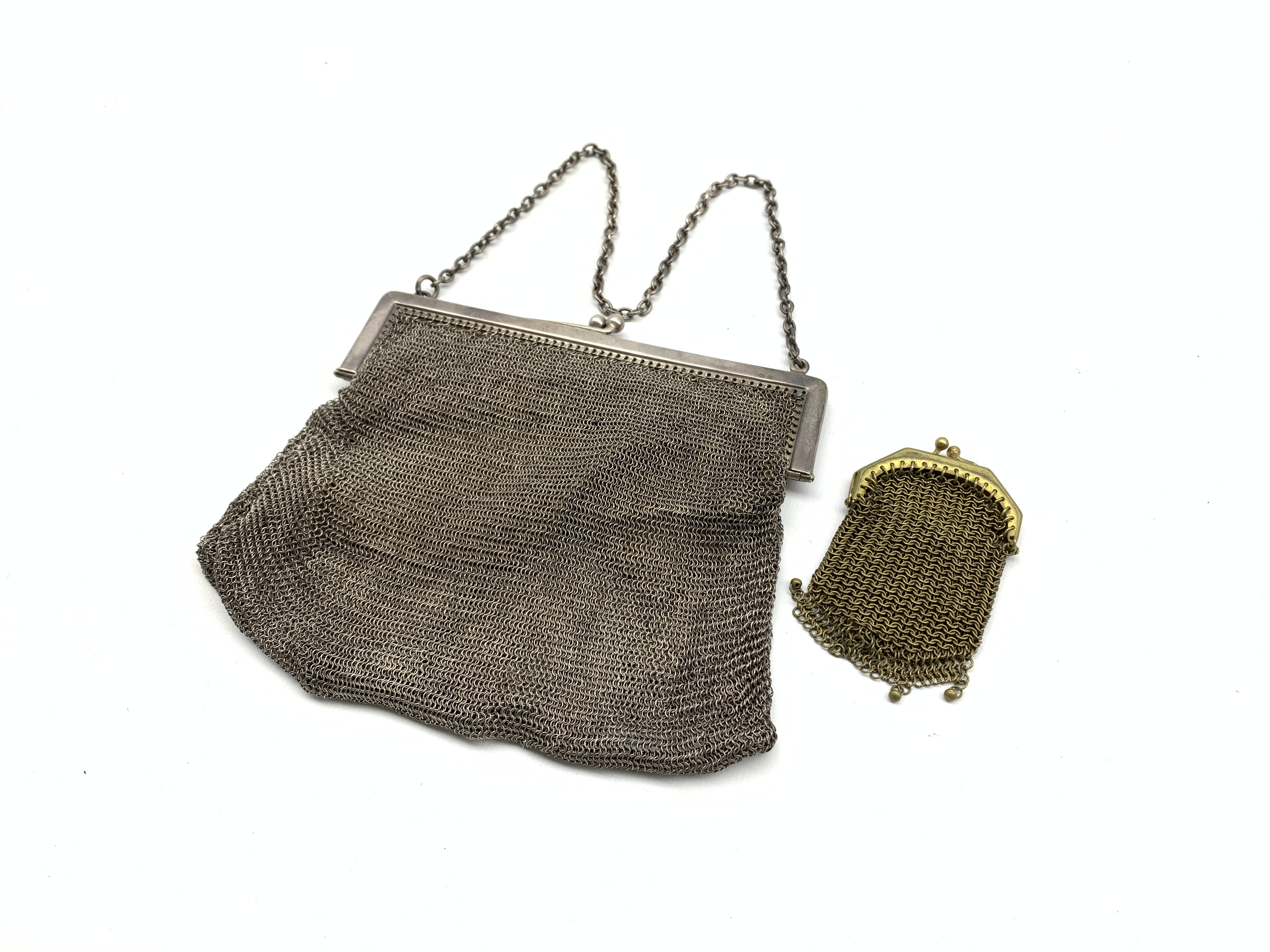 Lot 1161 - Silver and mesh evening purse with chain handle Birmingham 1916 and a small mesh purse