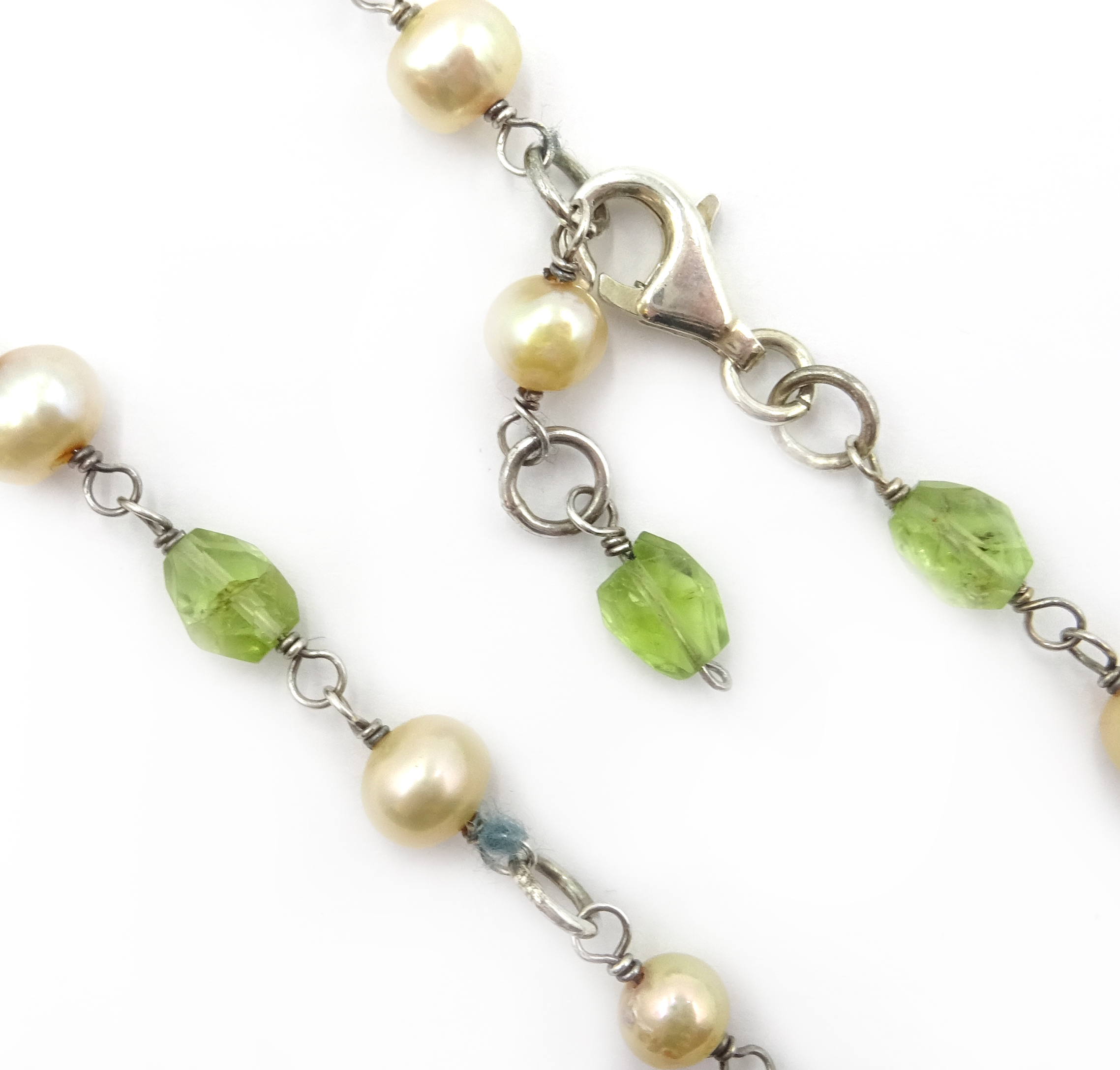 Lot 1008 - Silver peridot, pearl marcasite and enamel dragonfly necklace,