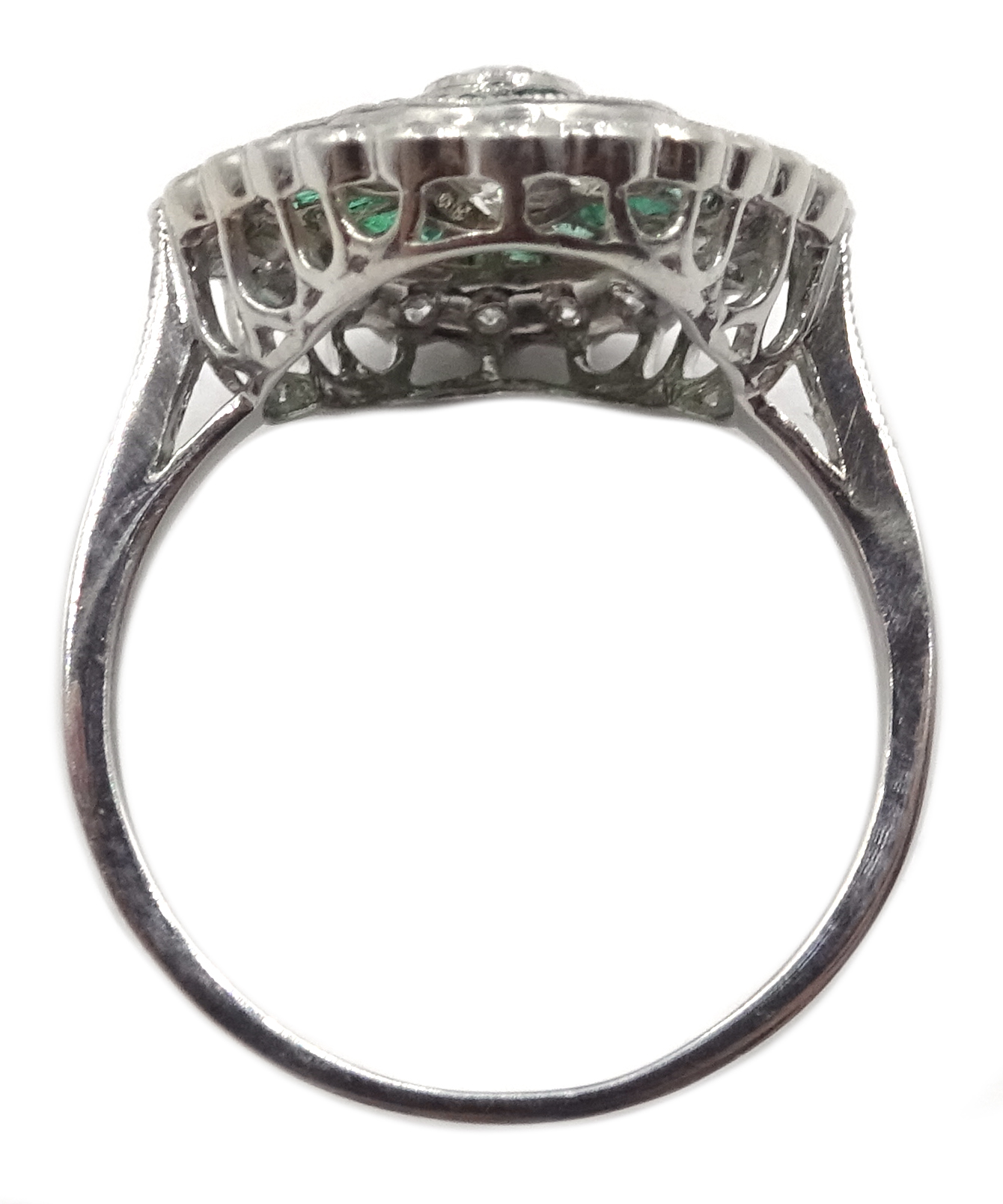 Lot 1057 - Platinum (tested) round brilliant cut diamond and calibre cut emerald ring,