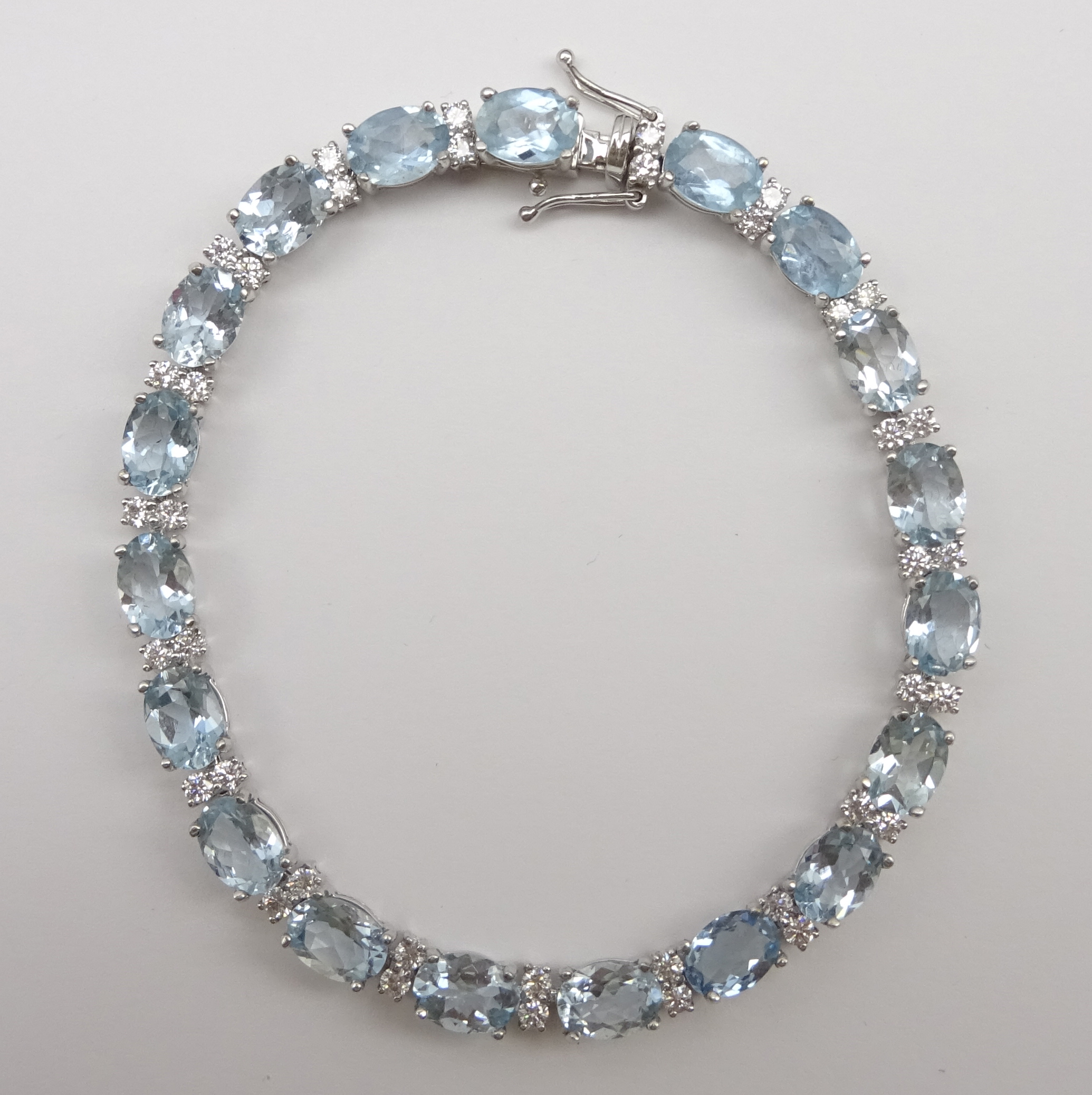 Lot 1039 - 18ct white gold aquamarine and diamond bracelet, stamped 750, aquamarine total weight 12.