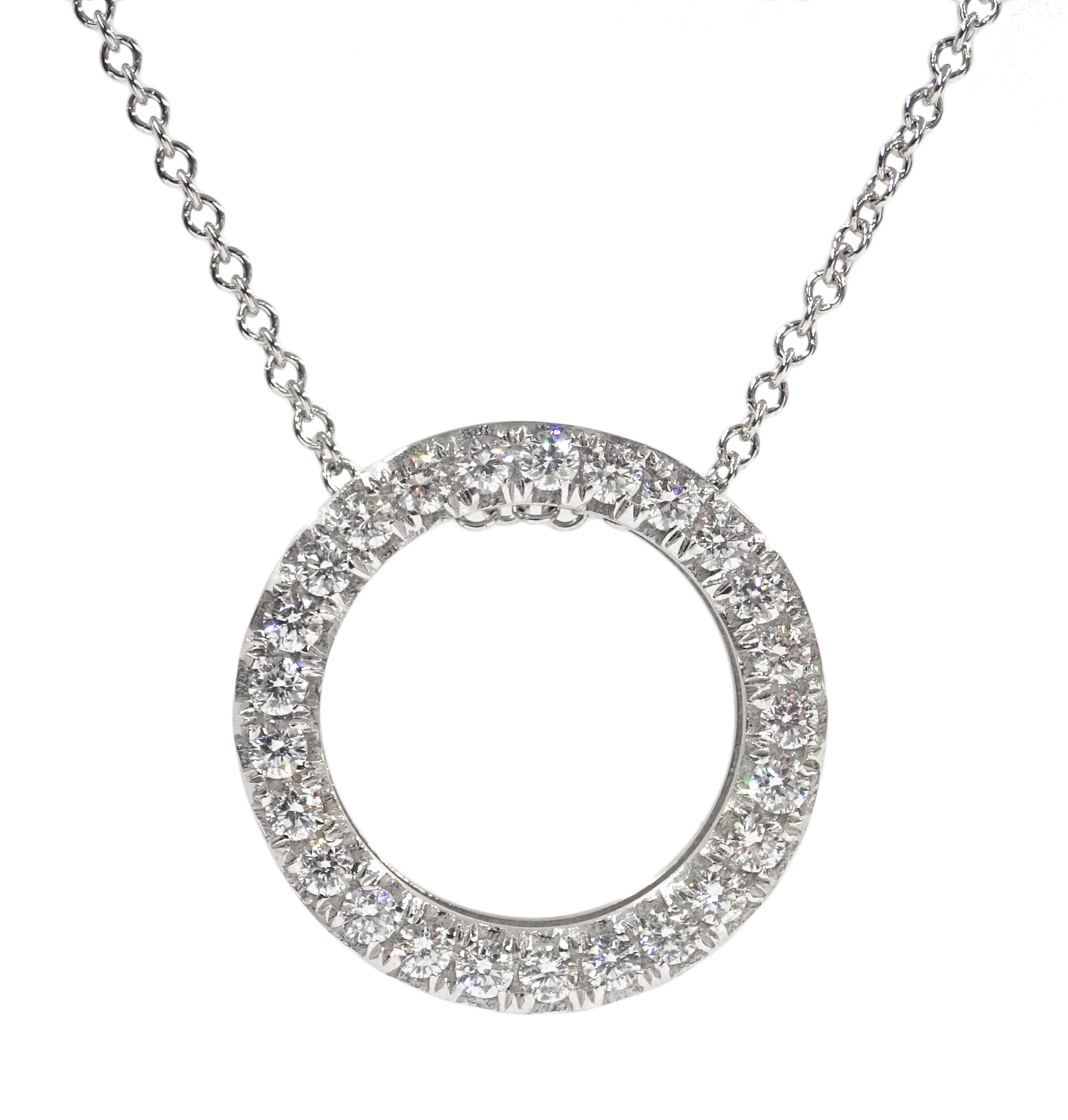 Lot 1042 - 18ct white gold diamond circular pendant necklace, stamped 750, diamond total weight 0.