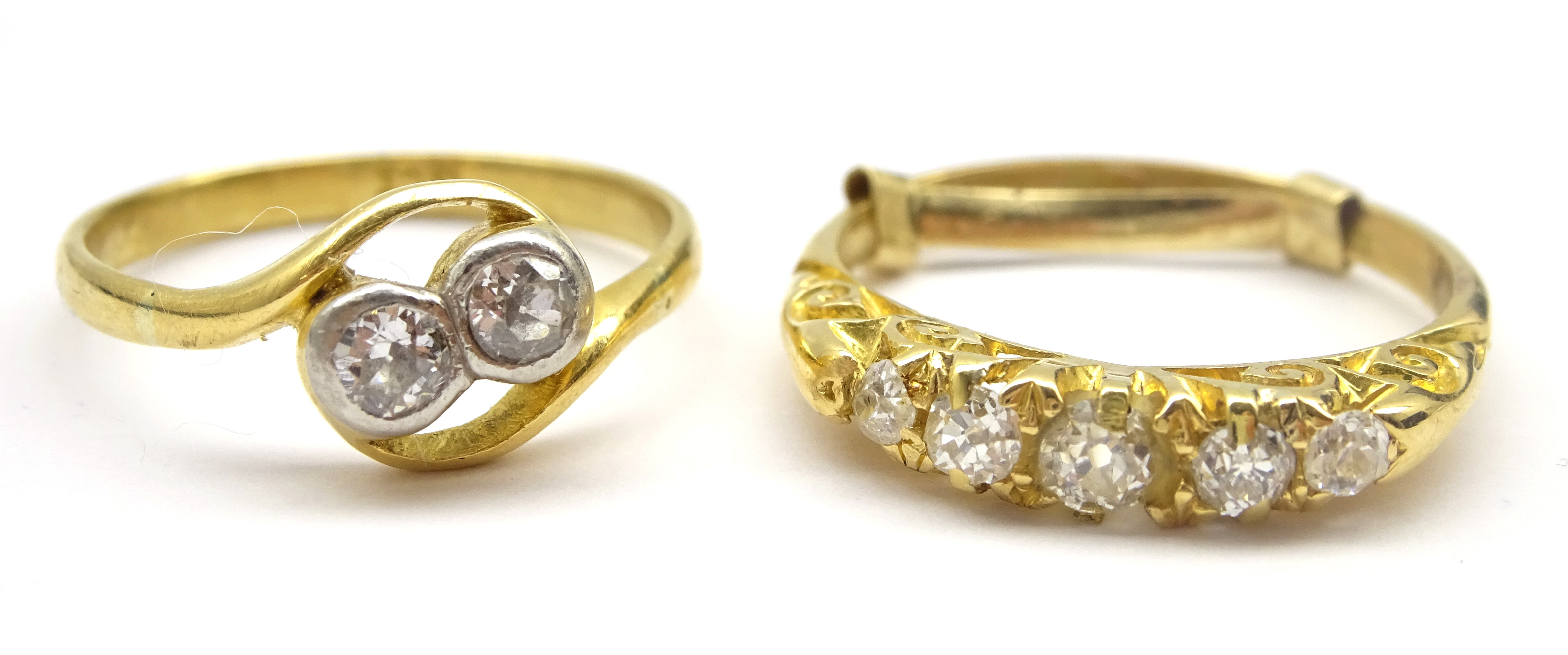 Lot 1028 - Gold early 20th century five stone diamond ring and a gold two stone crossover ring,