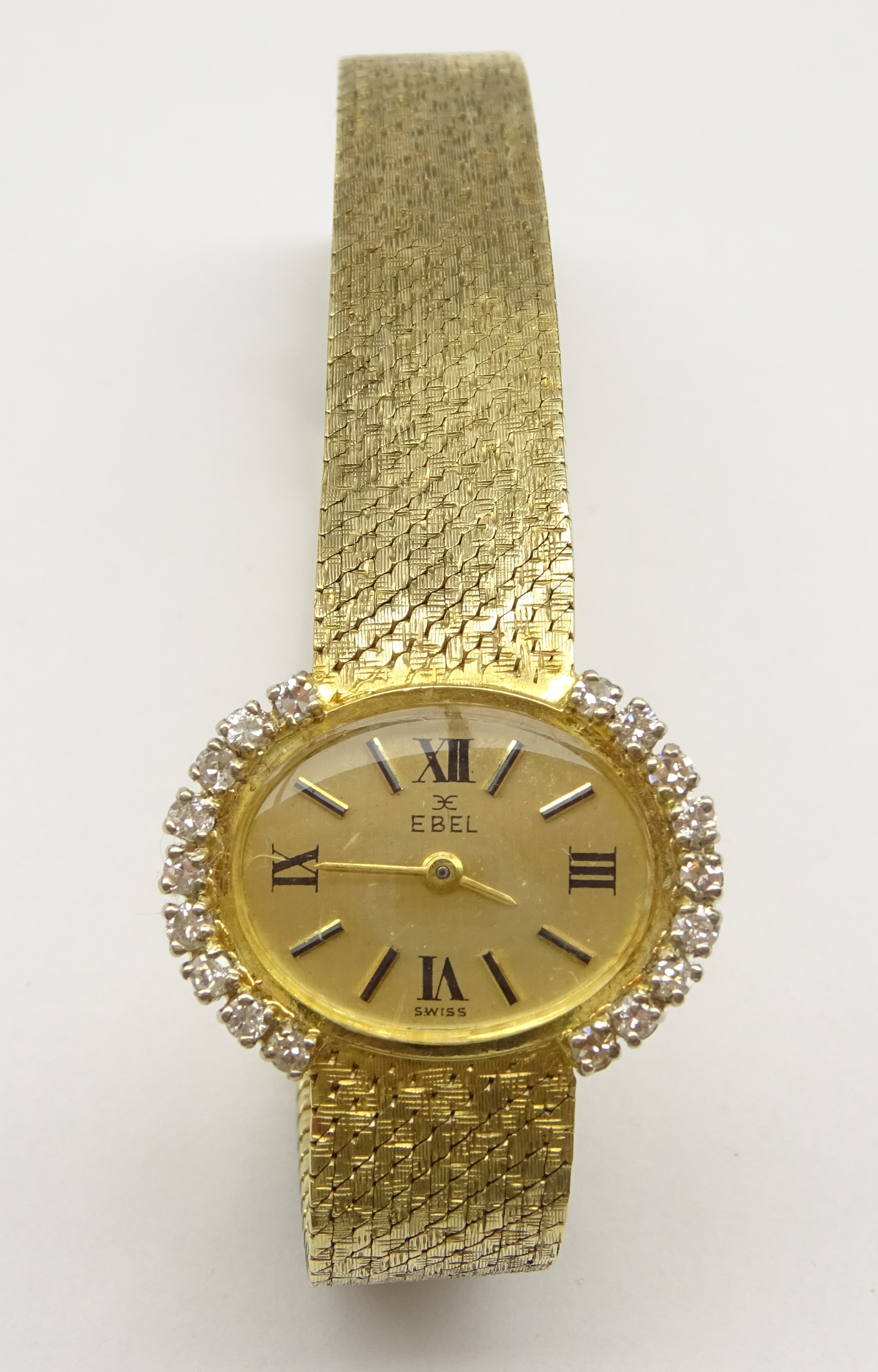 Lot 1023 - Ebel 9ct gold ladies manual wind wristwatch, the bezel set with nine diamonds on each side,
