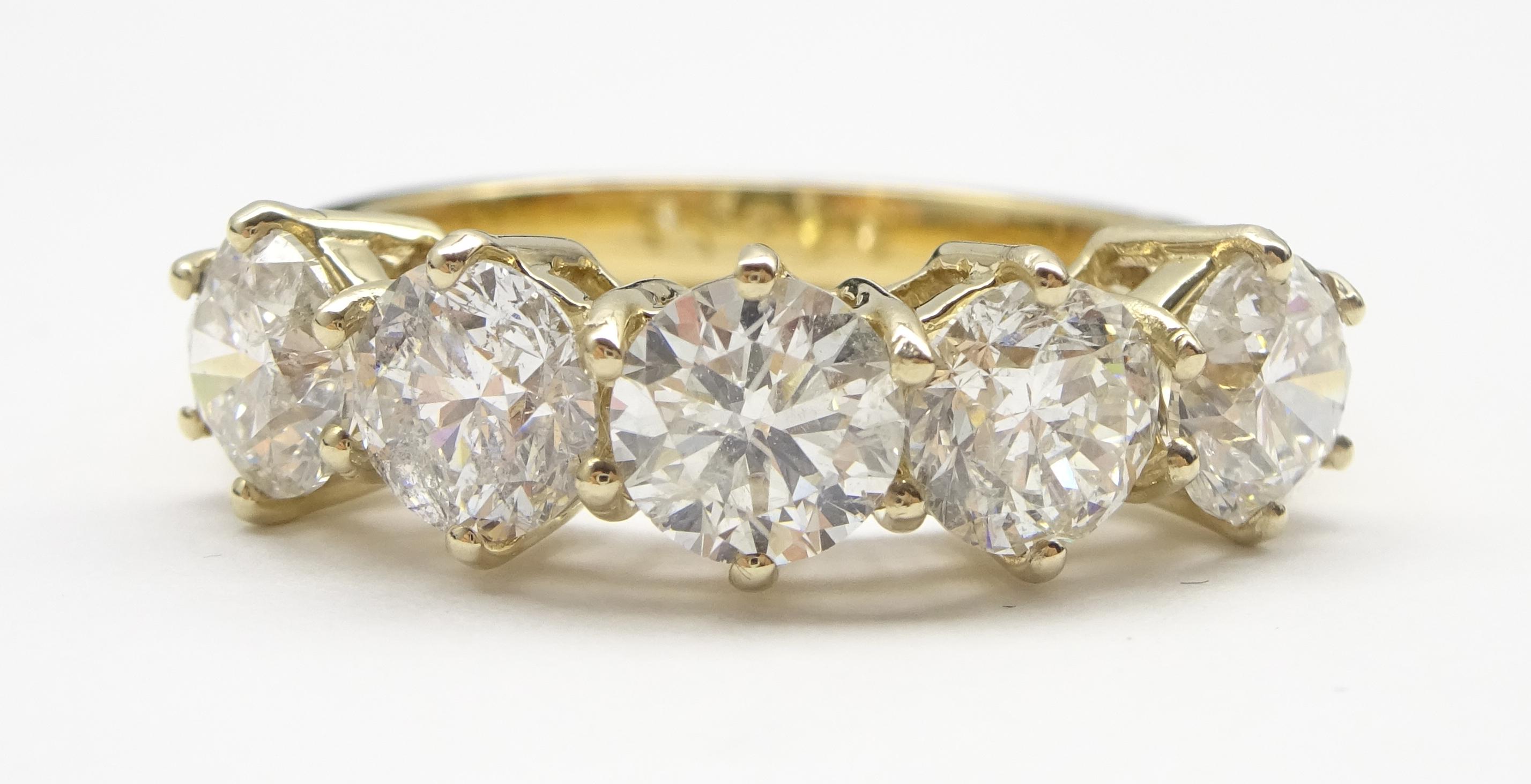 Lot 1012 - 18ct gold five stone round brilliant cut diamond ring hallmarked, total diamond weight 2.