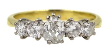 Gold five stone old cut diamond ring, stamped 18ct, the central pear shaped diamond approx 0.30 cara