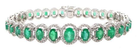 18ct gold graduating oval emerald bracelet, each emerald surrounded by brilliant cut diamonds, total