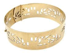 Gold hinged bangle with openwork decoration stamped 9ct, approx 19.78gm