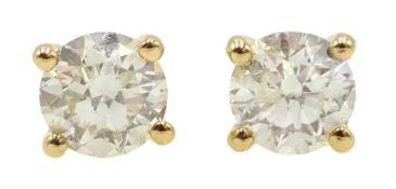 Pair of 18ct gold brilliant cut diamond stud earrings, diamond total weight apporx 0.80 carat