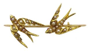 Victorian gold swallow bar brooch, both set with ruby eyes, in velvet lined box
