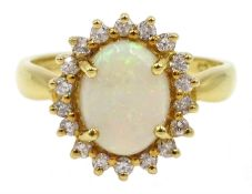 18ct gold opal and diamond cluster ring, hallmarked, retailed by Jill Freeman, in original box
