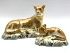 Royal Crown Derby 'Lioness' paperweight and another 'Lion Cub', both boxed and with gold stoppers