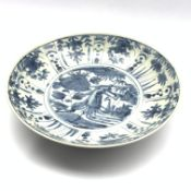 Chinese provincial charger decorated with flowers, foliage etc in blue and white D36cm