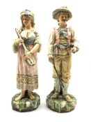 Pair of Continental Pottery standing figures of male and female musicians on naturalistic bases H50c