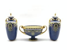 Royal Worcester garniture comprising pair of two handled vases and covers painted with panels of flo
