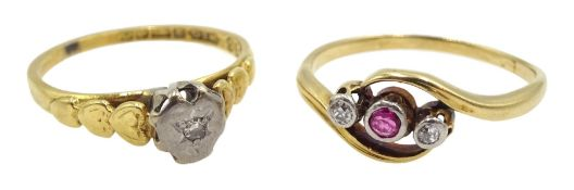 Gold three stone diamond and ruby ring and a single stone diamond ring, heart shaped design, both 18