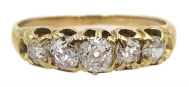 Gold graduating five stone old cut diamond ring, central diamond approx 0.20 carat