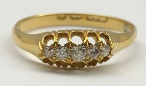 Victorian 18ct gold engagement ring with five small diamonds in an open work setting Size 'O'