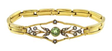 Early 20th century gold peridot and split seed pearl bracelet, on expanding strap, stamped 9ct