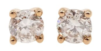Pair of 18ct rose gold brilliant cut diamond stud earrings, total diamond weight approx 0.50 carat