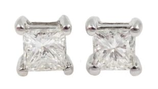 Pair of 18ct white gold princess cut diamond stud earrings, stamped 750, total diamond weight approx