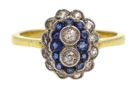 18ct gold milgrain set old cut diamond and sapphire ring, two central diamonds, with a surround of s