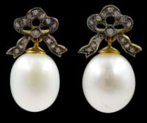 Pair of oval cultured pearl and diamond bow pendant earrings
