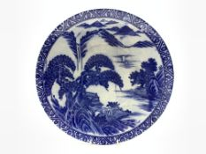 20th Century Japanese charger decorated with figures and lake landscape in blue and white D37cm