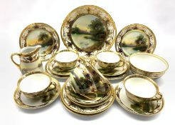 Noritake tea set decorated with swans in a lake landscape and gilt borders comprising six cups and s