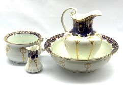 Early 20th century Bisto four piece toilet set retailed by Harrods