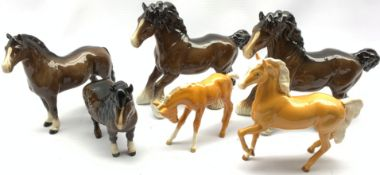 Six Beswick horses and foals including Two Cantering Shires in brown No. 975, Palomino foal No.947,