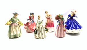 Six Royal Doulton figures comprising Carolyn, Miss Demure, Top O' the Hill, Daffy, Queen Victoria li