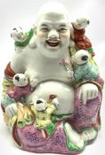 20th century Chinese porcelain figure of Hotei seated with five children, H21cm