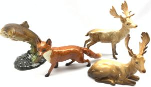 Beswick model of a Standing Stag No. 981, another of a Lying Stag No. 954, another of a Fox No. 1016