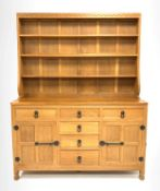 'Mouseman' 5' adzed oak dresser, three height plate rack over base fitted with six drawers, two cupb