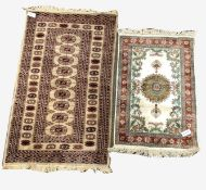 Afghan Bokhara style beige ground rug, with gul motif enclosed by triple guarded border, (141cm x 80