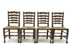 Set four early 20th century ash waved ladderback chairs, with string seats, raised on turned support