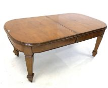 Early 20th century walnut extending dining table, quarter sawn veneered top with carving to edge, ra