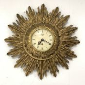 Smiths giltwood starburst wall clock, with white enamel dial and Roman numeral chapter ring, eight d