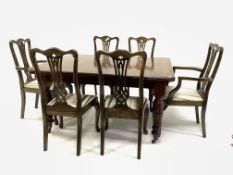 Edwardian walnut extending dining table, top with canted corners, raised on ring turned and reeded s