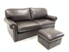 Modern leather upholstered three seat sofa with pull out bed, raised on compressed bun supports, W20