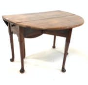 Georgian oak and elm oval drop leaf table, with gateleg action, drawer to one end over shaped apron,