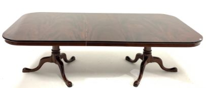 Late 20th century well figured mahogany twin pedestal dining table, the top raised on ring turned pe